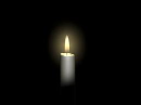 candle burning with a black background